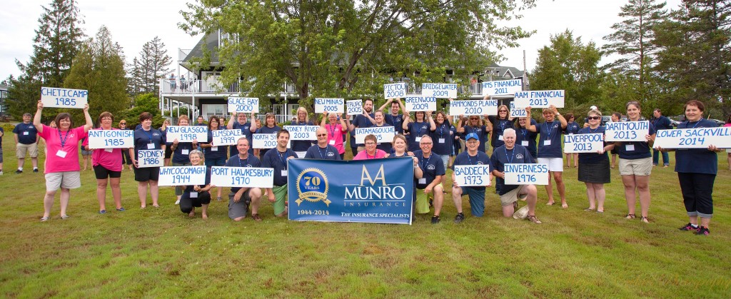 A A Munro teams show off signage as part of growth