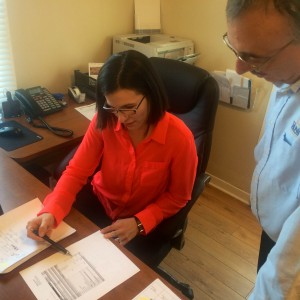 Doug Close and Karen George reviewing documents together.