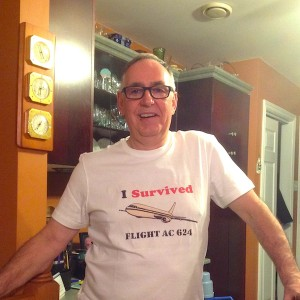 """Wayne in his new T-shirt that reads """"I survived flight AC 624"""""""