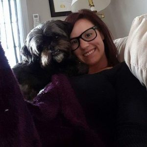 Courtney Elliot and her dog, a new hire with AA Munro Insurance's Lower Sackville office
