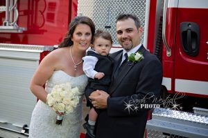 Holly Slauenwhite with her husband and son, a new hire at AA Munro Insurance Bridgewater location