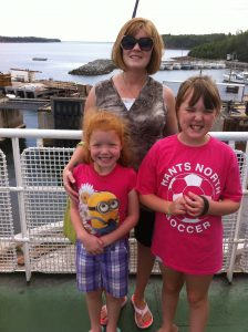 New hire Jennifer MacPhee and her children, with AA Munro Insurance Lower Sackville office