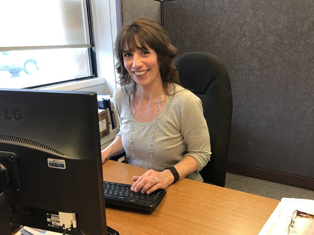 Michelle Green at her desk, AA Munro Insurance Turo location