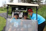 Children in golf cart during Maritime NHL'ers for Kids