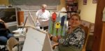 Tanya Young shows her painting at a paint night in New Glasgow