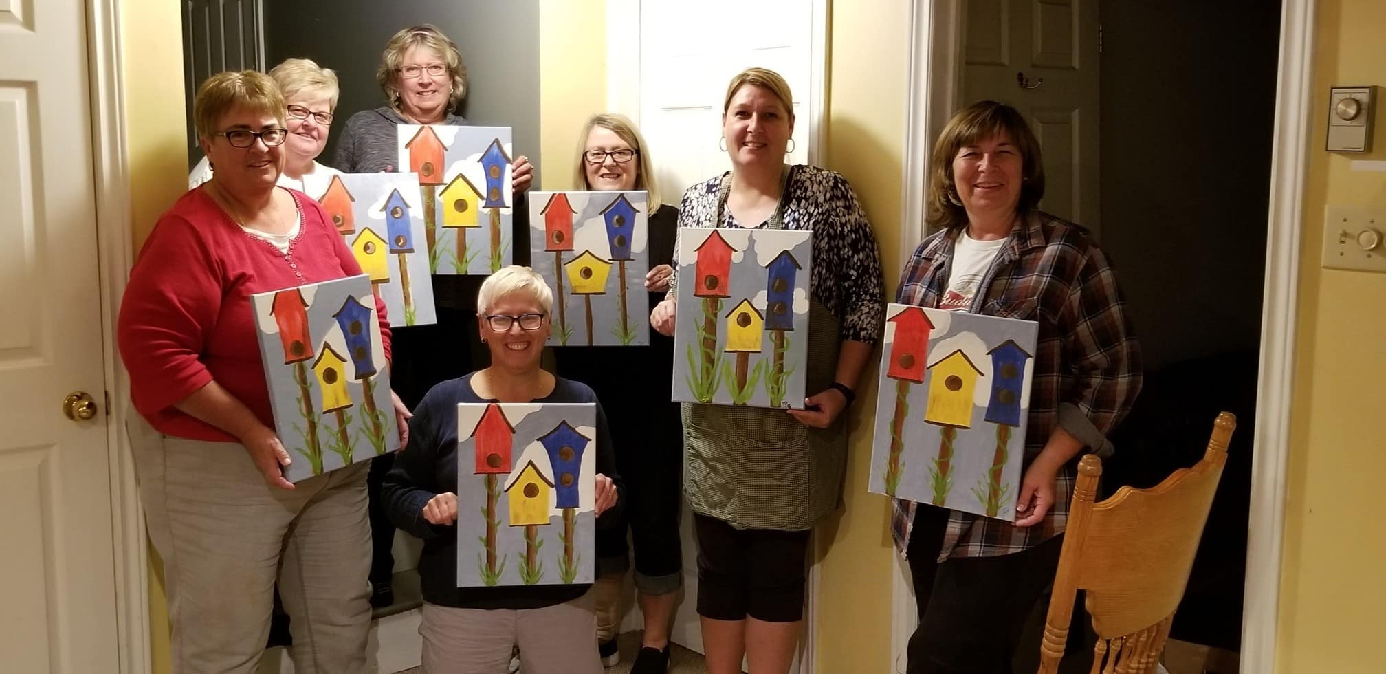 Brokers from AA Munro Insurance at a paint night in New Glasgow