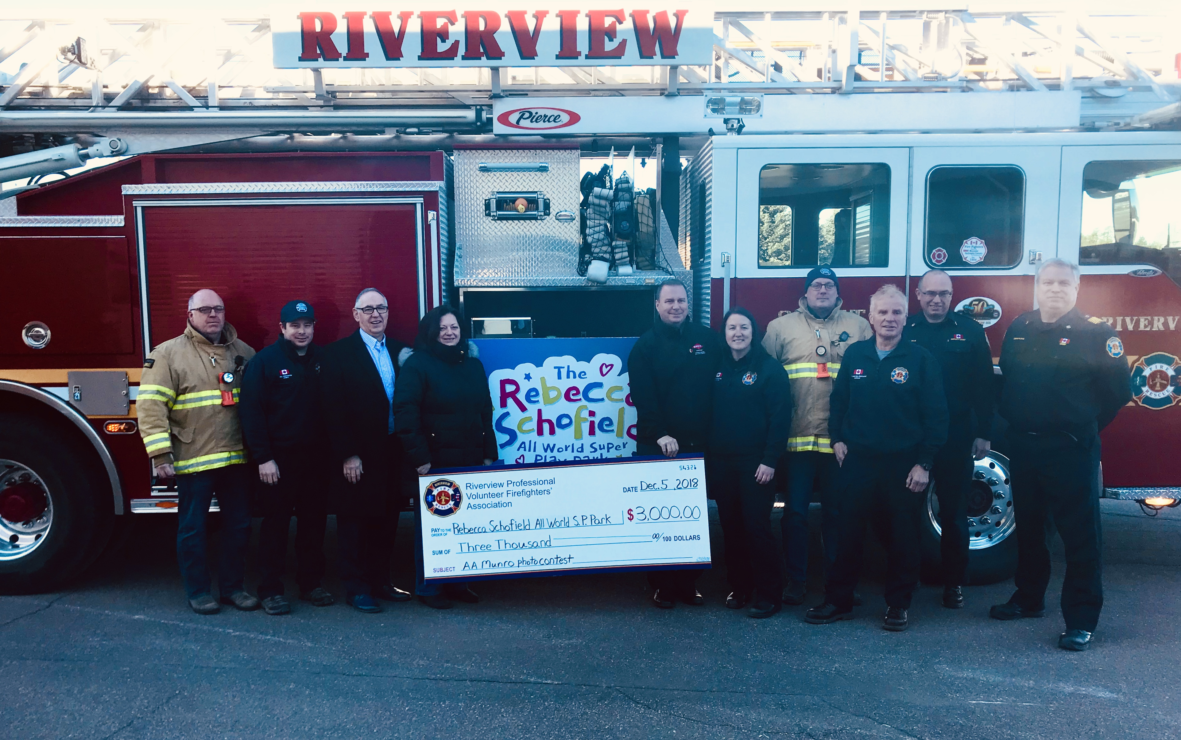 Firefighters in Riverview, New Brunswick gather with Anne Schofield and Wayne Ezekiel