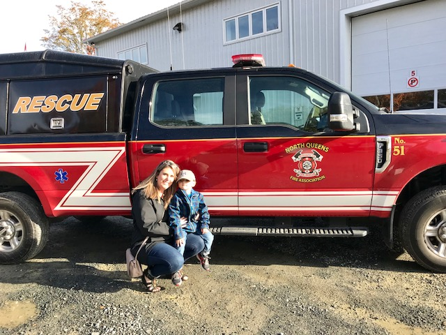 Mother and son with a rescue truck